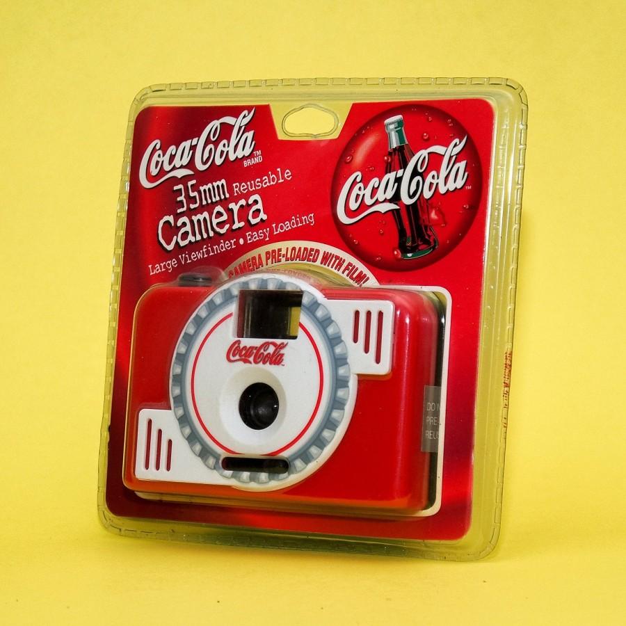 Coca Cola fotoaparatas